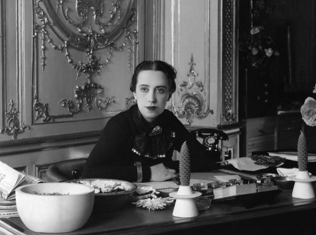a woman sitting at her desk